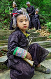 Chinese teenager in traditional ethnic dress Miao tribe, armed w Royalty Free Stock Images