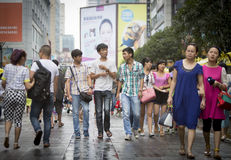 Chinese teenagers on a shopping street Royalty Free Stock Photos