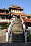 Chinese temple. Stairs leading up a chinese temple agaisnt blue sky Stock Photo