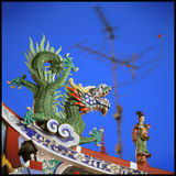 Chinese Temple. Rooftop decorations of a Chinese Buddhist temple in Singapore stock images