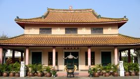 Chinese Temple. A Chinese temple with an incense burner in front of it Royalty Free Stock Images