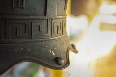 Chinese temple bell miniature with blessing text mean happy on background. Chinese temple bell miniature with blessing text mean happy on blurred background stock photos
