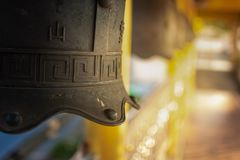 Chinese temple bell miniature with blessing text mean happy on background. Chinese temple bell miniature with blessing text mean happy on blurred background royalty free stock images