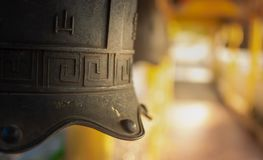 Chinese temple bell miniature with blessing text mean happy on background. Chinese temple bell miniature with blessing text mean happy on blurred background stock photography