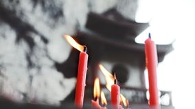 Chinese temple and Candle fire royalty free stock photo