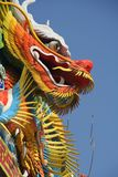 Chinese temple dragon. Asian temple dragon against blue sky Stock Images