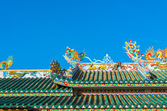 Chinese temple. Dragon sculpture on the roof of a Chinese temple royalty free stock photos