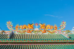 Chinese temple. Dragon sculpture on the roof of a Chinese temple stock image