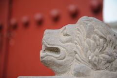 Chinese beside the temple of the red stone lion Stock Images