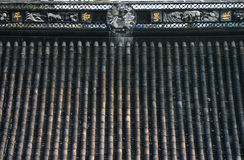 Chinese temple roof. Artwork and decorative carvings on the roof of a Chinese temple Stock Photo