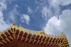 Chinese temple roof. With cloudy sky stock images