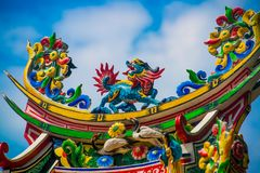 Chinese temple roof.A fragment of a Chinese temple,dragon. Beautiful multi-colored ornament on a religious building Royalty Free Stock Image
