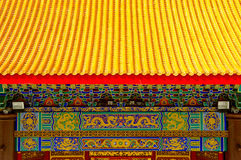 Chinese temple's roof and painting. Yellow tiled rooftop in Chinese temple Royalty Free Stock Photography