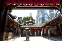 Chinese Temple in Singapore. View of Thian Hock Keng in Chinatown, Singapore to the modern skyscrapers royalty free stock images