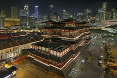 Chinese Temple in Singapore Chinatown at Night. Chinese Temple in Chinatown with Singapore City Skyline at Night Royalty Free Stock Photos
