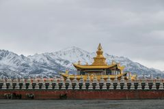 Chinese temple under snow mountain Royalty Free Stock Image