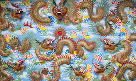 Chinese Temple Wall Art. A highly colorful and decorative section of a wall in a Chinese temple Stock Photo