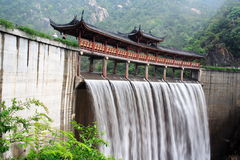 Chinese temple with waterfall Royalty Free Stock Images