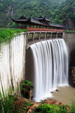 Chinese temple with waterfall Royalty Free Stock Photography