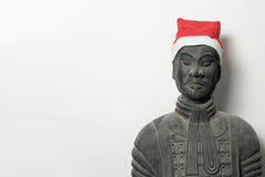 Chinese terracotta warrior statue with santa hat Royalty Free Stock Photo