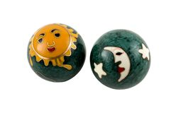Chinese Therapy Balls. Two Chinese therapy balls with painted sun, moon and stars Stock Photos