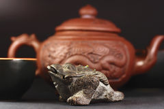Chinese three-legged a toad of happiness. And a set for tea ceremony Stock Photo