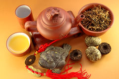 Chinese three-legged a toad of happiness. And a set for tea ceremony Stock Image
