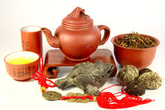 Chinese three-legged a toad of happiness. And a set for tea ceremony Royalty Free Stock Photo