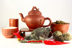 Chinese three-legged a toad of happiness. And a set for tea ceremony Stock Photography