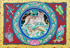 Chinese tigers art on the wall. With flute,basket,blow and lotus Stock Image