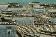 Chinese Tiles Roofs. An aerial view over Chinese tiles roofs in an ancient Chinese village of Hongcun in Anhui Province. Listed in the UNESCO heritage list Royalty Free Stock Images