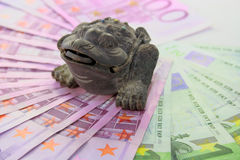 The Chinese toad of happiness. With three paws sits on money Royalty Free Stock Photos