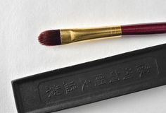 Chinese tools for painting. Ink stone  and paintbrush  isolated on white background. Chinese tools for painting Stock Image