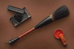 Chinese tools for painting with paintbrushes ink stone and stamp Royalty Free Stock Image