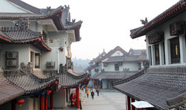 Chinese tour sites. With ancient building and some vistors.Taken inWuhan mountain of Shiyan city of China.On Dec.12,2011 Royalty Free Stock Image