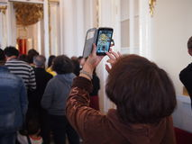 Chinese Tourist in the Hermitage stock images