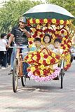 Chinese tourist kids having a sustainable and colorful trishaw ride in malacca