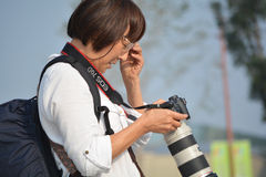 Chinese tourist. Old chinese tourist checking the photos Stock Photo