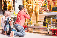 Chinese tourist pray for endless happiness and health Stock Images