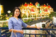Chinese tourist visiting entertainment park at night Stock Photo
