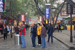 Chinese tourist couples are shopping at the Muslim market in Xian, China Royalty Free Stock Photos