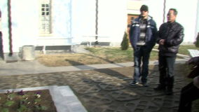 Chinese tourists near the grave of Vanga in Rupite. Temple of Saint Petka built Vanga, Bulgarias tourist attractions, a place of pilgrimage for fans in Rupite stock video footage