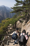 Chinese tourists walking on Yellow Mountain Huangshan China Stock Photos
