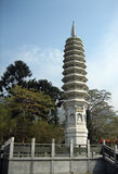 Chinese tower. Tall Chinese tower or monument with art work and statues Stock Image