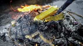 Burning gold paper for ancestor. Chinese tradition to burn money paper for pass away ancestor. So they can have good life spending money after dead royalty free stock images