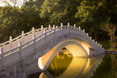 Chinese traditional arch bridge. Chinese garden :A stone arch bridge in sunset Stock Photography