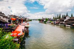 Chinese traditional architecture and canal in Shanghai Zhujiajiao water town. Shanghai, China - August 8, 2016 : Chinese traditional architecture and canal in Stock Photos