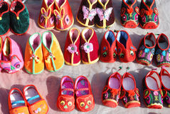 Chinese traditional baby cloth shoes. Chinese baby shoes zodiac pattern stock photos