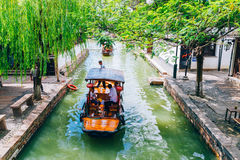 Chinese traditional boats with tree on canal of Shanghai Zhujiajiao water town. Shanghai, China - August 8, 2016 : Chinese traditional boats with tree on canal Stock Photography