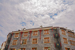 Chinese traditional building in cloudy summer sky Stock Image